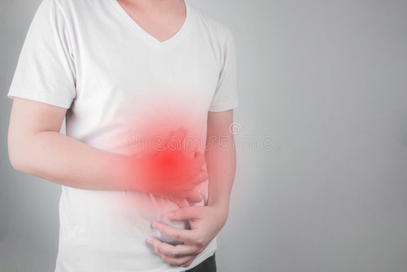 Азиатские молодые люди страдают от язв желудка гастрит причинил инфекцией h здравоохранение и здоровье бактерий привратников желу стоковые фото