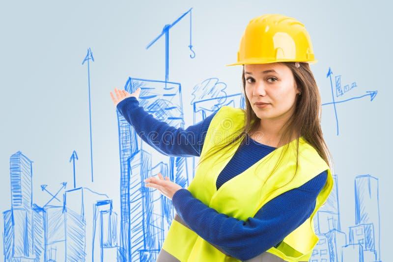 Архитектор представляя эскиз плана города стоковое фото