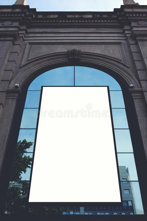Аdvertising mock up big empty banner in urban setting on building. Blank billboard with copy space for your text message or content, public information board royalty free stock photo