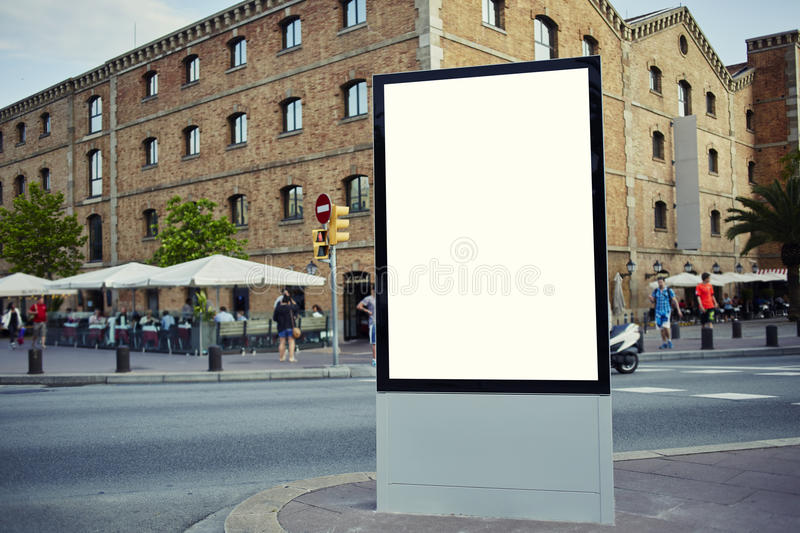 Аdvertising mock up empty banner in metropolitan city at beautiful sunny day. Blank billboard with copy space for your text message or content, public royalty free stock images
