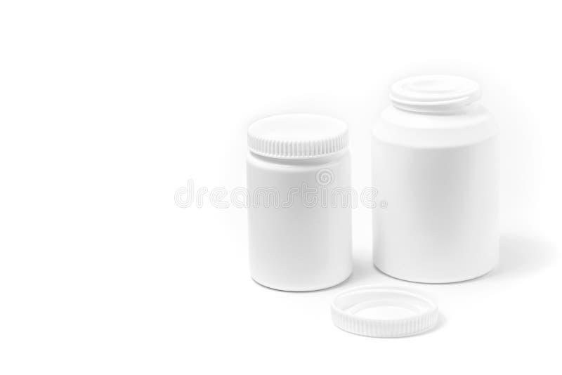 2 бутылки таблеток медицины белых изолированных на белизне стоковое изображение