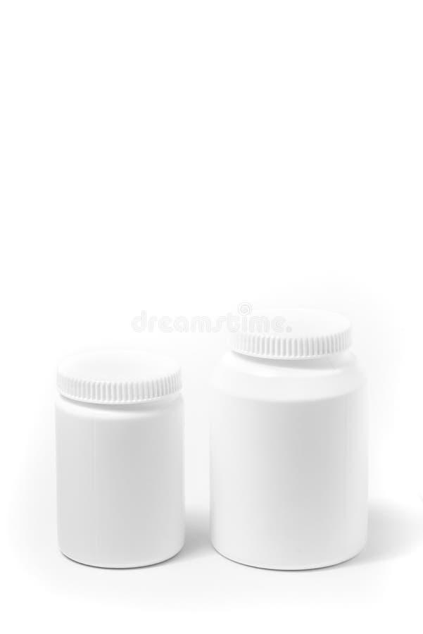 2 бутылки таблеток медицины белых изолированных на белизне стоковое изображение rf