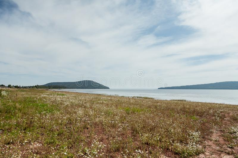 Russia Bratsk 2014 morning shore meadow royalty free stock photos