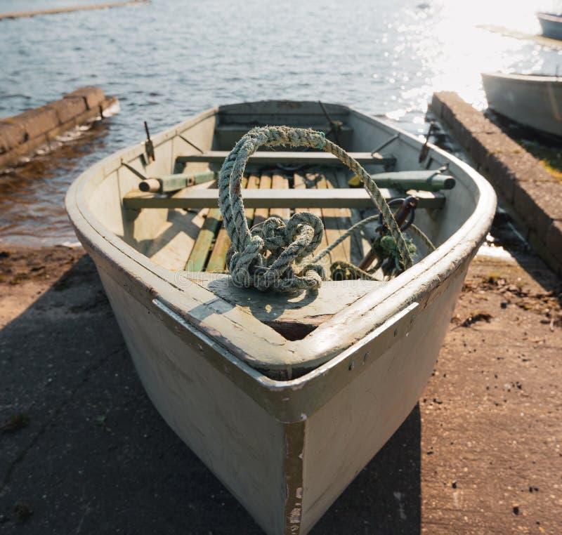 Весельная лодка в доке стоковое фото rf
