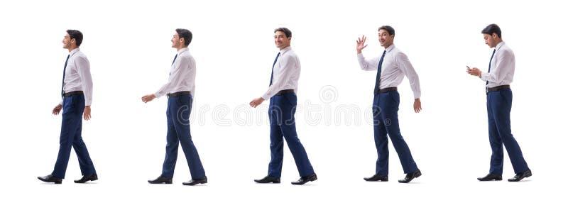 Взгляд со стороны бизнесмена идя стоя изолированный на белой предпосылке стоковые фото