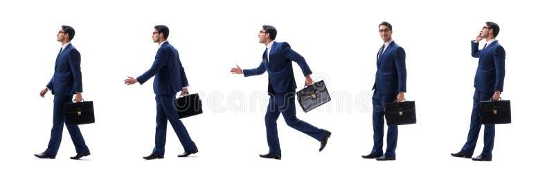 Взгляд со стороны бизнесмена идя стоя изолированный на белой предпосылке стоковые фотографии rf