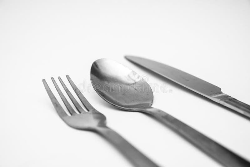 Вилка, нож, фон ложки белый стоковая фотография rf