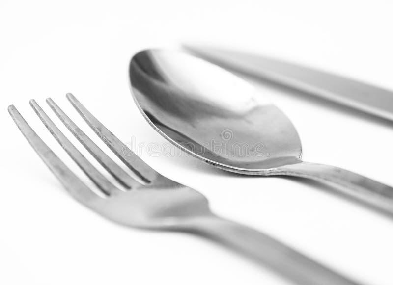 Вилка, нож, фон ложки белый стоковые фото