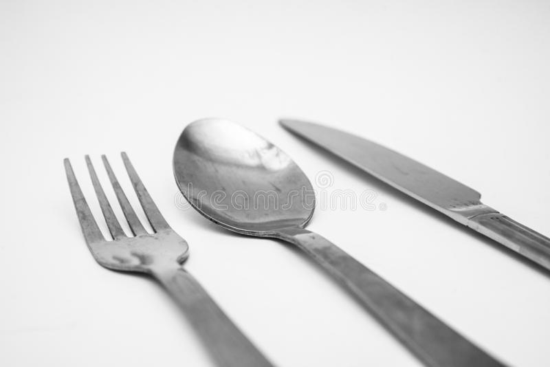 Вилка, нож, фон ложки белый стоковое изображение rf