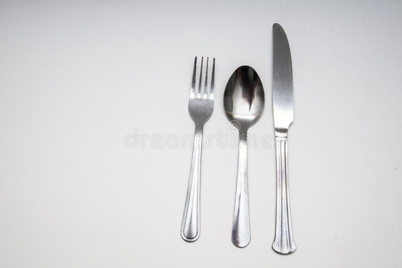 Вилка, нож, фон ложки белый стоковое изображение