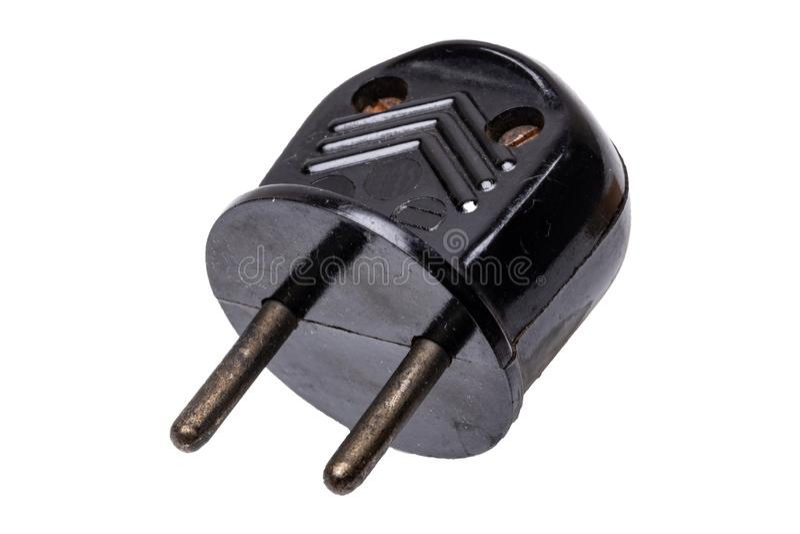 Винтажная электрическая штепсельная вилка Конец-вверх старой ржавой электрической штепсельной вилки власти черных изолированной н стоковые изображения rf