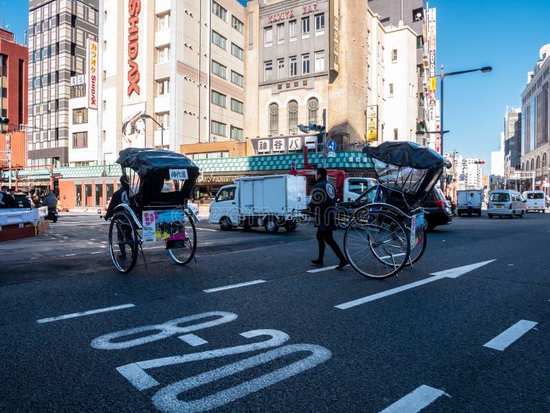 Всадники рикши от Токио стоковое фото