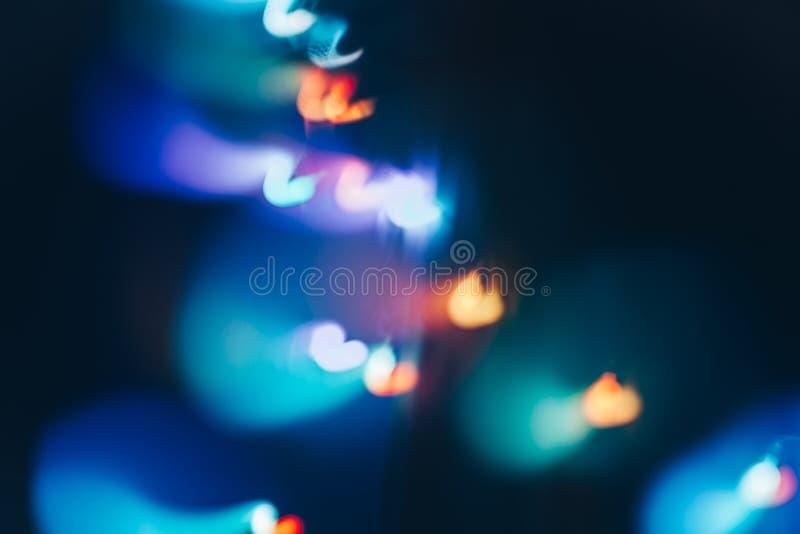 Волшебное bokeh рождества светов на черной предпосылке стоковые изображения