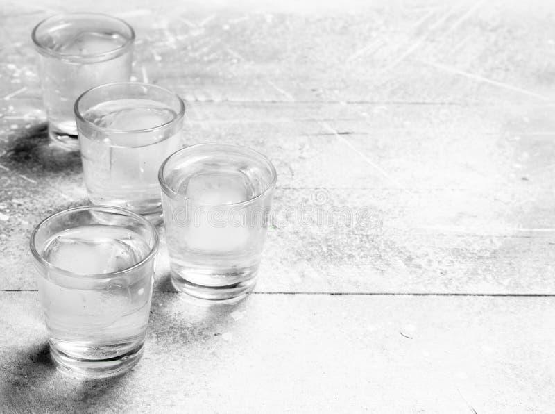 Водочка в стекле съемки стоковые фотографии rf