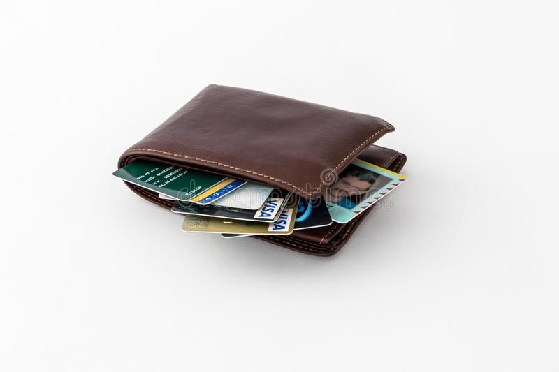 Ð'rown leather wallet and several credit cards and club cards isolated on white background. Nahariyya, Israel - September 15, 2018 : Ð'rown leather wallet royalty free stock image