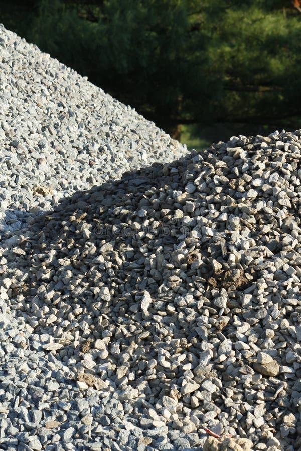 Гравий складывает - серый каменный конец вверх по - конспект стоковая фотография rf