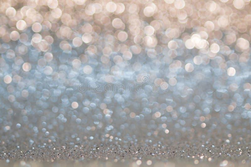 Голубая, бежевая, серебряная белизна, русая абстрактная светлая предпосылка, светя света, сверкная блестящие света рождества Запа стоковое фото rf
