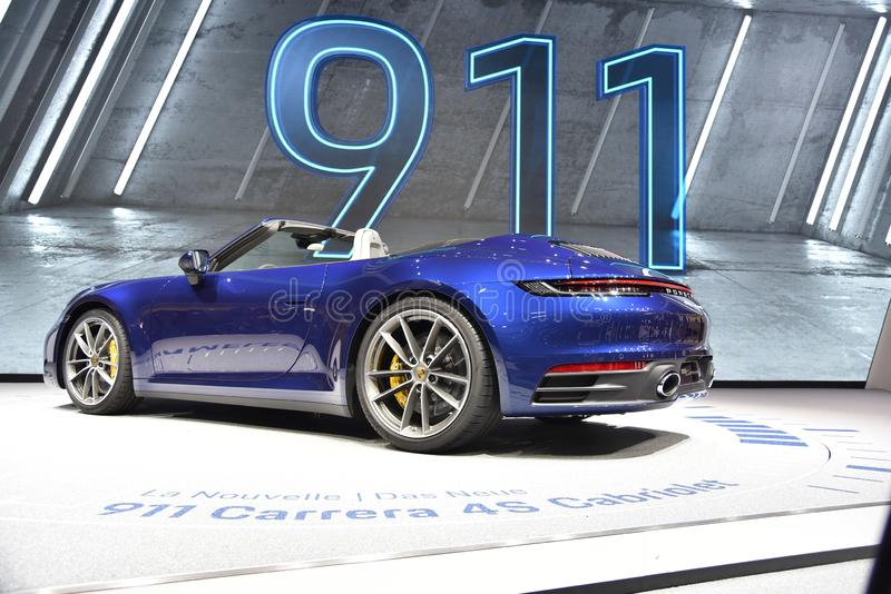 Женева, Швейцария - 5-ое марта 2019: Автомобиль Cabriolet Порше 911 Carrera 4s showcased на 89th мотор-шоу Женевы международном стоковое фото rf
