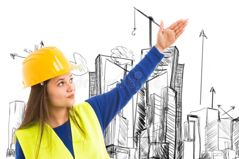 Женский архитектор представляя угол эскиза стоковые фотографии rf
