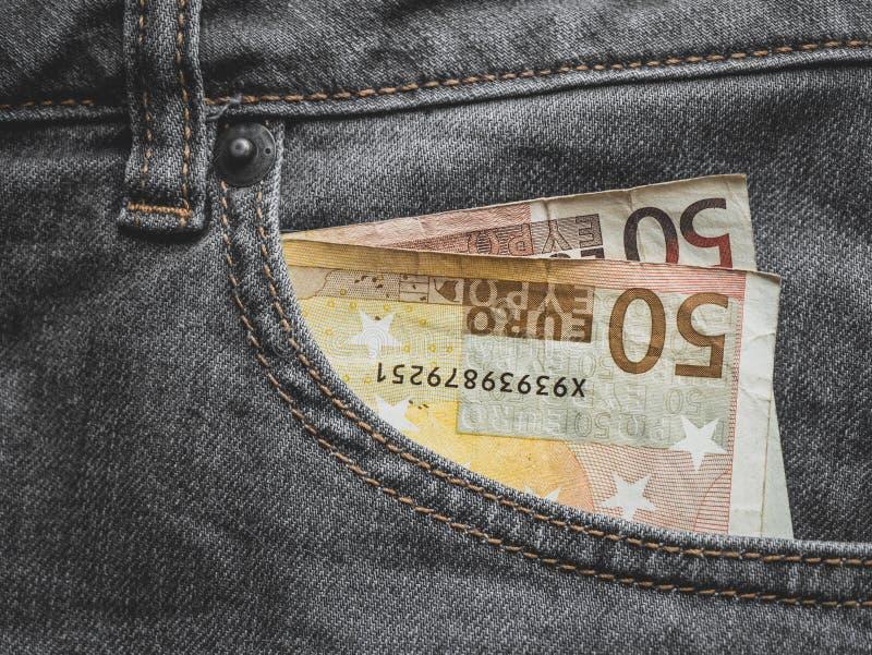 Закройте вверх банкноты евро 50 в кармане стоковые фотографии rf