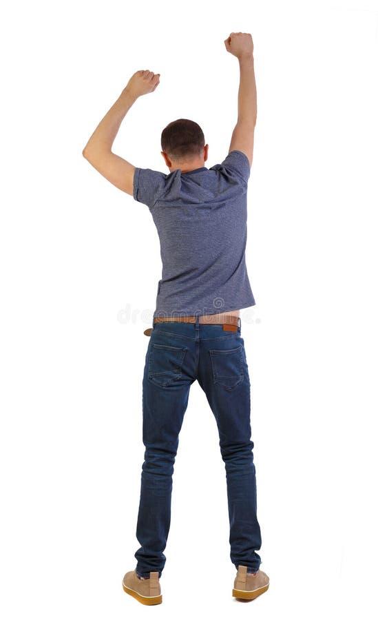 Задний взгляд танцуя человека наблюдать парня стоковые изображения