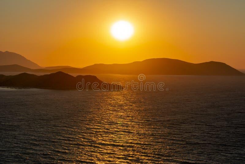 Заход солнца над островами Dodecanese от замка Kritinia, Греции стоковые изображения rf