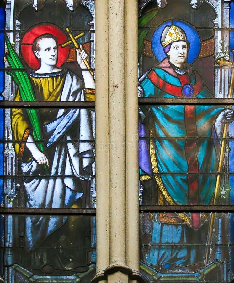 Католические Святые - цветное стекло в церков Severin Святого, Париже стоковое фото rf
