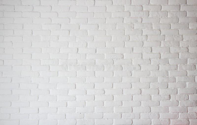 Кирпичная стена белой предпосылки текстуры цвета в комнате стоковое фото