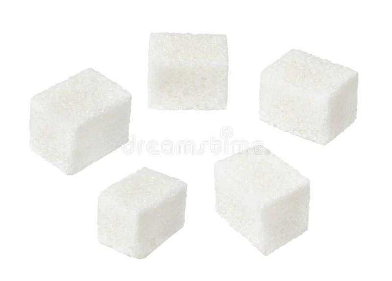Куски немедленного сахара Работа со структурой и формой Предпосылка изолированная белизной стоковые фото