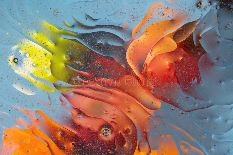 Красивый конец вверх по взгляду красному, оранжевому, голубому, желтому красочному абстрактному дизайну, текстуре стоковое фото rf
