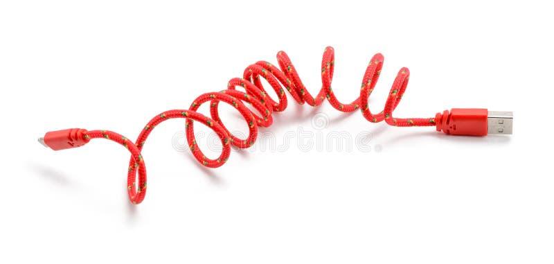 Красный кабель USB на белизне стоковые изображения