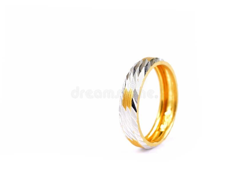 Кольцо серебра и золота изолированное на белой предпосылке стоковое фото