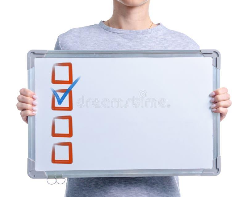 Контрольная пометка притяжки Whiteboard в руке женщины стоковая фотография rf