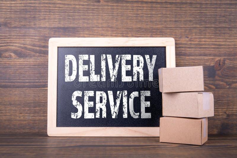 Концепция обслуживания поставки доска и картонные коробки стоковая фотография
