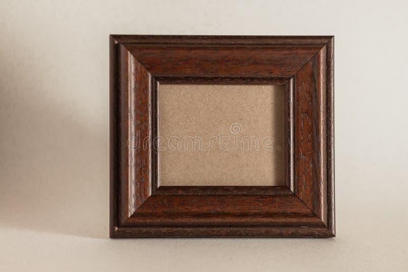 коричневейте фото рамки деревянное стоковые изображения