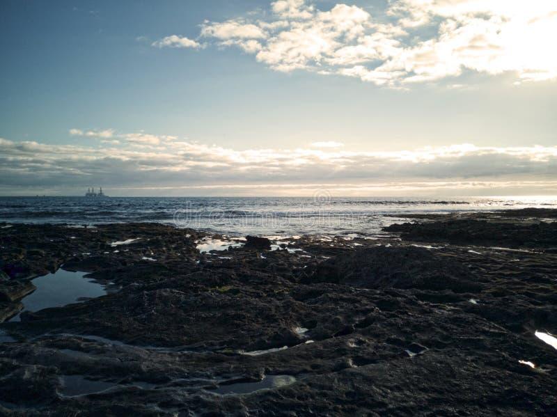 Ландшафт рассвета в пляже El Medano, Тенерифе, Канарских островах, Испании стоковая фотография rf