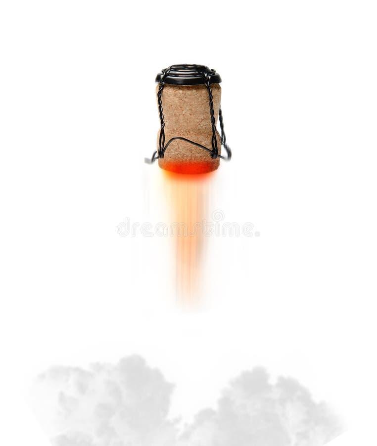 """Летание пробочки Шампань как ракета с пламенем рвя из """"сопла """" атмосфера праздничная стоковое фото"""