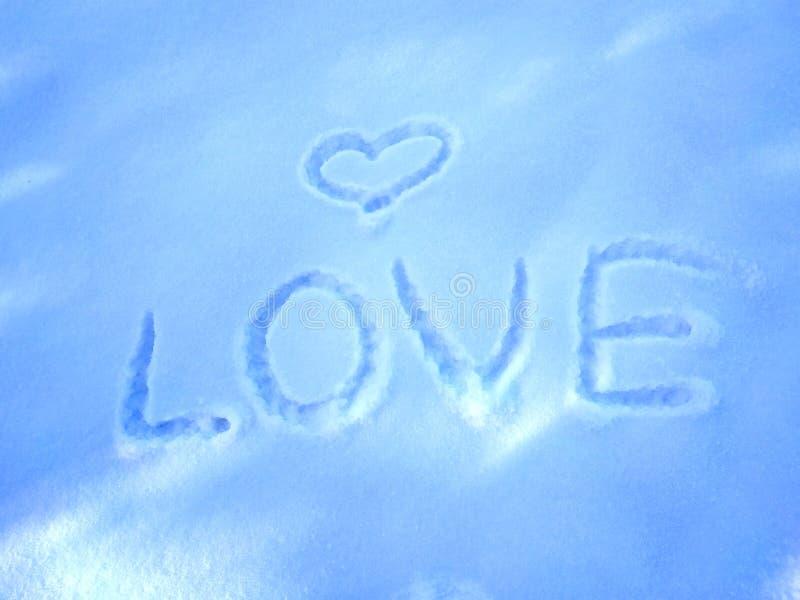 Любовь надписи в предпосылке снега- первоначальной для карт, приглашений, поздравлений на день Валентайн, 14-ое февраля стоковые изображения