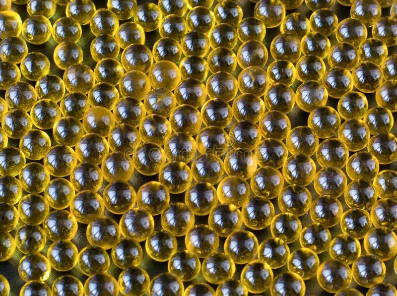 Масло Треска-печени Закройте вверх рыбий жир на черной предпосылке стоковая фотография rf
