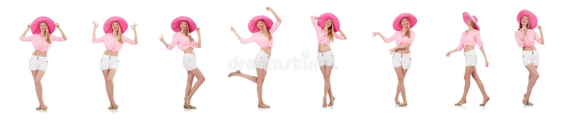 Молодая танцуя модель в шляпе Панамы изолированной на белизне стоковые изображения