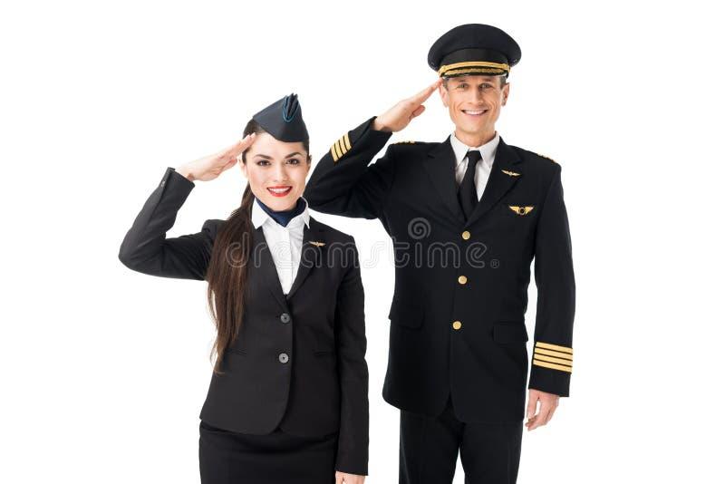 Молодой салютовать stewardess и пилота стоковые изображения rf