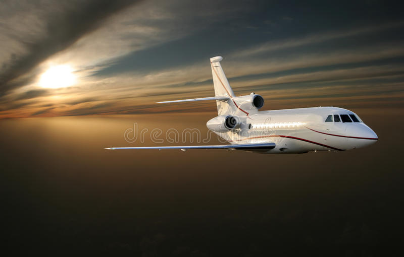 Ðœorning flight. Luxury jet plane above Earth. Beautiful (smiling) luxury airplane is flying (arriving) in the first sunrise beams above stock images