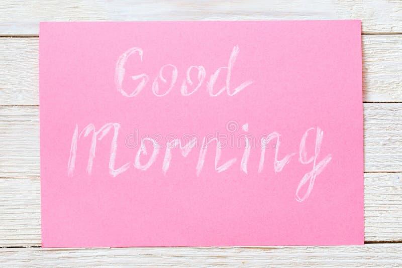 Надпись в меле на розовой предпосылке стоковое изображение