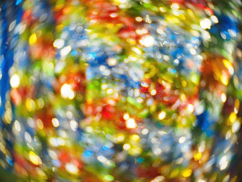 Пестротканым мягк-сфокусированная конспектом яркая блестящая и сияющая праздничная предпосылка bokeh стоковая фотография rf