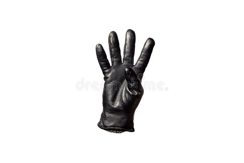 Перчатка черноты крупного плана кожаная, пальцы показывая 4 белизна изолированная предпосылкой Символы концепции, знаки, номера стоковое изображение