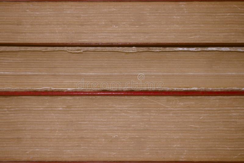 Предпосылка, текстура штабелированных книг стоковые изображения