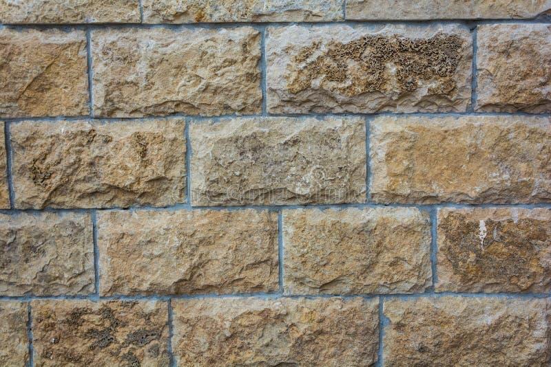 Предпосылка текстурированная кирпичной стеной в желтой текстуре тонов стоковые фотографии rf