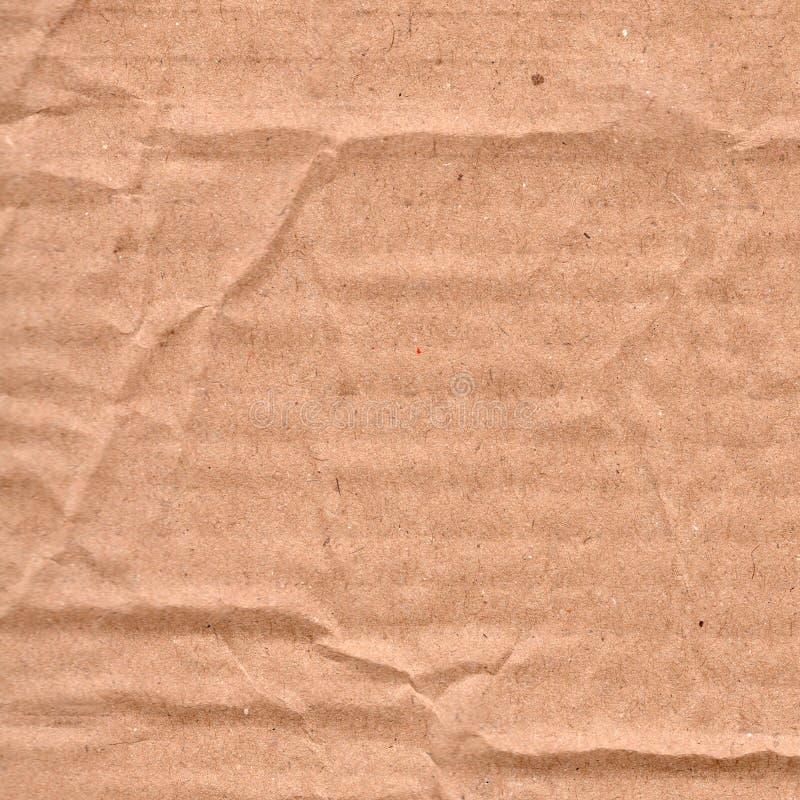 Предпосылка текстуры grunge крупного плана старая скомканная коричневая бумажная Доска листа бумаги Брауна с космосом для текста, стоковые изображения