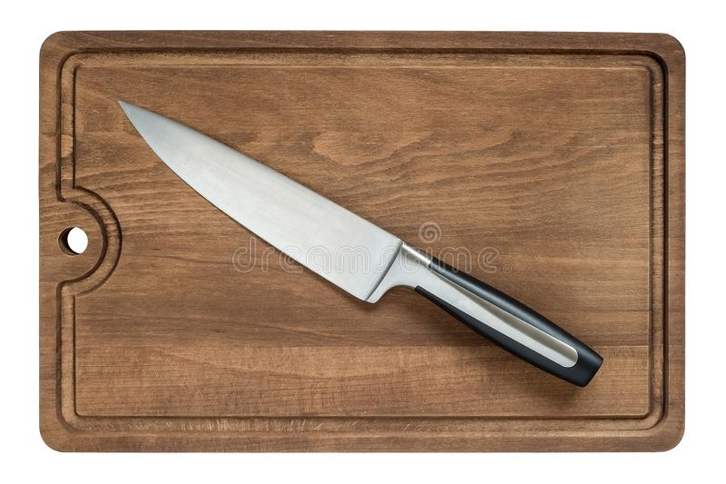 Профессиональный кухонный нож шеф-повара с 20 см лезвие 8 дюймов на коричневом взгляде сверху разделочной доски стоковое изображение rf