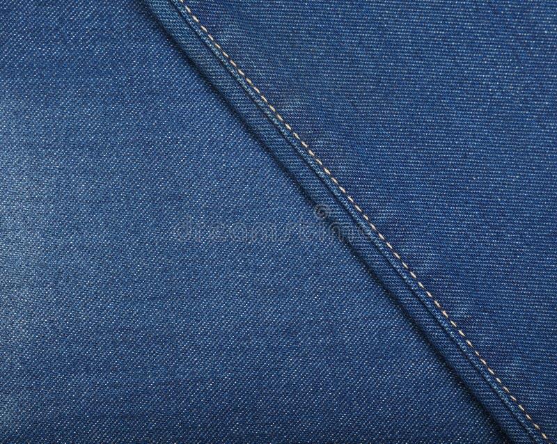 Помытая синью предпосылка текстуры джинсовой ткани джинсов стоковая фотография